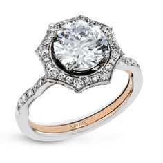 With a rippling halo design, milgrain edging, .23 ctw of side diamonds, and a romantic touch of yellow gold on the interior of the rings, this engagement ring is a unique take on a lovely vintage-inspired design.
