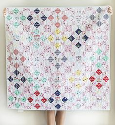 If you've been searching for a simple and elegant quilt to welcome your new grandbaby, then you'll fall head over heels for this dreamy pastel quilt pattern. The Market Squares Quilt Pattern is a gorgeous baby quilt pattern that hearkens back to trad