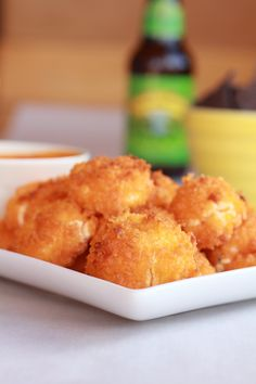 """Oven """"fried"""" goat cheese balls in buffalo sauce! Yes, it is as amazing as it sounds!    Ingredients    10 ounce goat cheese log  1/2 cup blue cheese crumble (optional, see note)  2 whole eggs, beaten  2 cups panko breadcrumbs  1/2 cup (1 stick) butter, melted  ½ cups Franks Red Hot  1 teaspoon seasoned salt  Fresh Greens, To Serve"""