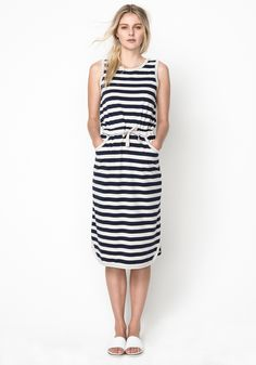 Our Linea striped styles are Summer essentials! This striped tank midi dress features a classic tank top cut, a drawcord at the waist to add shape and a curved hem with slight side splits for comfort. This is such as easy, comfortable and stylish piece to wear, work it with sandals for the weekend, or dress it up with a great pair of heels when you want to add a little something.