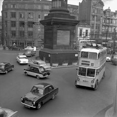 A trolleybus heading past Grey's Monument towards Central Station Newcastle in 1961 Newcastle England, Northumberland England, Buses And Trains, Great North, North East England, Central Station, Best Places To Live, Places Of Interest, Local History