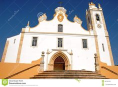 Portimao in Portugal. Portimao is a city of the Algarve region in southern Portugal. The city is characterized by the old fishing neighborhood with narrow streets and alleys intricate. This region and this town are among the most visited in Portugal. Photos of the village church. Photos of the facade Dellachiesa. Church small and simple, but its color predominantly white, which goes well with the color of the lower part and the staircase, and the contrast with the blue color of the sky, make…