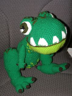 T-Rex! This guy is HUGE for amigurumi! I am still learning how to embroider so the teeth could use some work. I also made a little building for him to stomp on :D