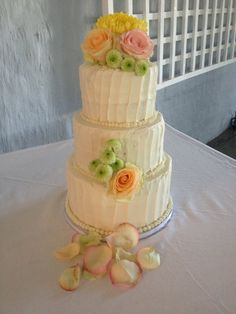 Three Tier Cream Buttercream Wedding Cake with Vertical Lines and Fresh Flowers