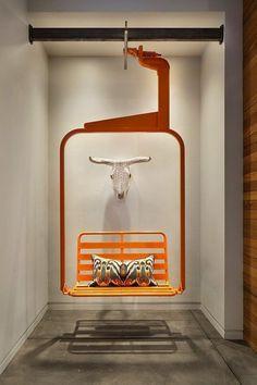 fauteuil suspendu de design unique en forme de télésiège en métal orange