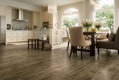 This is the Gallery Oak Chestnut floor from Armstrong.  A great looking luxury vinyl.   http://www.truehardwoods.com/product/armstrong-luxury-vinyl-vivero-best-ingrilock-u2031gallery-oak-chestnut/
