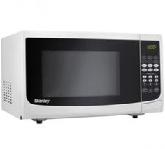 White Danby's counter top microwaves are not only practical and economical, they're stylish too! Danby microwaves are well suited for the dorm room, office, cot 700 Watt Microwave, Compact Microwave, Countertop Microwave Oven, Countertop Microwaves, Specialty Appliances, Small Appliances, Kitchen Appliances, Cool Kitchen Gadgets