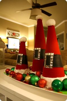 Santa hats from styrofoam cones. Cute idea. No directions but the picture gives you a good idea on how to make them