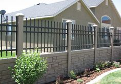 SimTek Faux Rock Fence with Ornamental Aluminum Fence Top by City Fence , Buffalo, NY & WNY