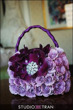 The flower girl's purse could tie in with the theme or colours of the wedding Flower Girl Bouquet, Flower Bag, Flower Girl Basket, Deco Floral, Arte Floral, Floral Design, Creative Flower Arrangements, Floral Arrangements, Floral Bags