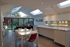 A contrasting contemporary kitchen extension, with a unique glass gable feature within the roof construction. Glass Extension, Roof Extension, Extension Ideas, Extension Google, Bungalow Extensions, House Extensions, Kitchen Extensions, Contemporary Building, Contemporary Bedroom
