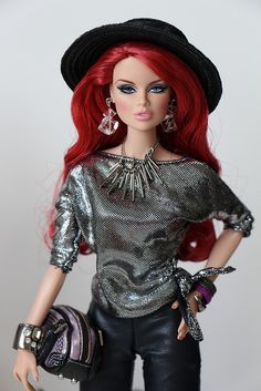 Great outfit on this fashion doll! Love the silver aspects of the outfit :)