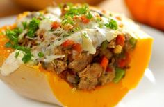 When it's cold outside and I'm looking for a warm hearty meal one of my favorite dishes to make is this sausage stuffed butternut squash. The butternut squash is filling and when you combine with sausage, cheese, onions, and peppers your taste buds are going on a trip to heaven. Check out the quick video below to see how it all comes together: Follow us on Pinterest >> Tip Hero Ingredients: 1 butternut squash (1 ½-2 lbs), cut in half and seeds scooped out 1 lb ground Italian sau...