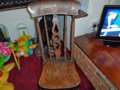 Windsor Style Rocking Chair (£20 to £40) - This a very typical pattern little Thames Valley or Windsor style rocking chair that graced the cottage homes of Britain for decades and are still popular now. They are all generally constructed from beech for the turned parts of the chair, elm for the seat and ash for bentwood parts which would include the rockers.
