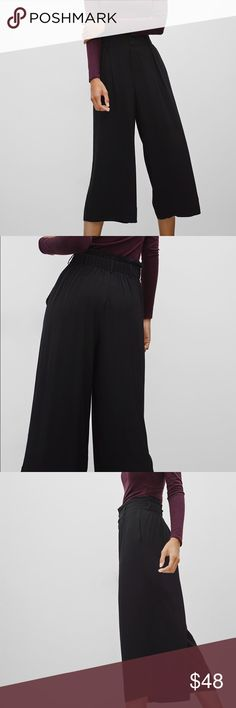 Aritzia Sunday Best Kizzia Pant Worn once! These culottes are made with a heavy crepe that drapes beautifully and has fluid movement. The wide-leg silhouette also has a high-waisted fit with a paperbag waist and a zip-fly closure. Slash pockets sit at the hip. Aritzia Pants