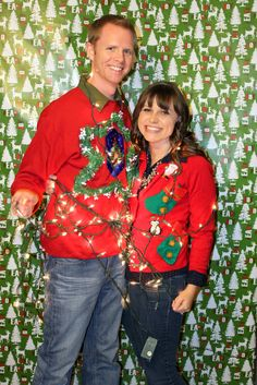 must have at our Ugly sweater party photo booth. Use Christmas paper or table cloth and have each couple take photos