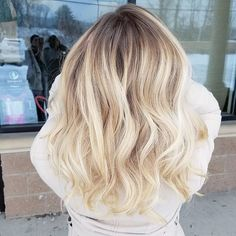 Softly rooted winter blonde using Oligo Blacklight Balayage clay lightener with 40 volume and olaplex. Toned with PM Shines 9V and 9NB