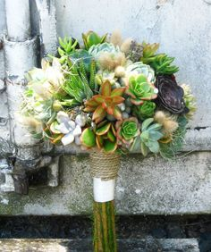 Amazing variety of succulents and natural materials in this bouquet