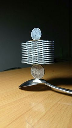Precisely Stacked Coin Towers That Defy Gravity