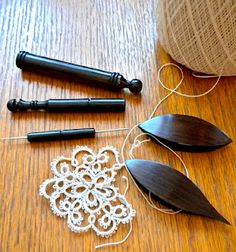 Beautiful tatting shuttles and hook/pick tool.  Makes learning to tat enjoyable.