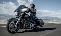 sensationnel feeling of freedom with new model of Harley Davidson, only with white smile,