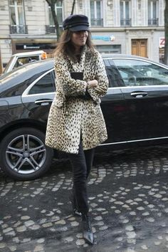 All you need to create the perfect fall outfit? Black jeans and an animal print coat.
