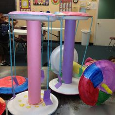 Amusement park ride, made from paper plates, tempera paint and paper towel roll.