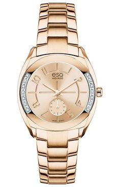 """ESQ Origin - Women's ESQ Origin watch, 28 mm wide tonneau-shaped rose gold ion-plated stainless steel case with 14 smoked white diamonds (0.067 t.c.w.) and """"e"""" logo crown, round rose gold-toned dial with matching hands, etched Arabic numerals and small seconds subdial, rose gold ion-plated stainless steel link bracelet with logo-engraved deployment clasp, Swiss quartz movement, mineral crystal, water resistant to 30 meters. --- $595"""