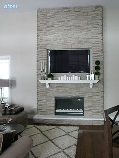 This fireplace is simply panels of stone veneer placed over a wooden frame that her husband built. The firebox is an electric insert. The whole thing took two days! Doesn't it look amazing? See more from Jaclyn at Love and Bellinis. White and Gray Fireplace Makeovers | betterafter.net: