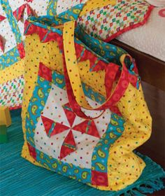"""Playing with Pinwheels Tote"" designed by Karen DuMont using fabric the Safari Sweet Hearts collection by Diane Eichler for Red Rooster Fabrics."