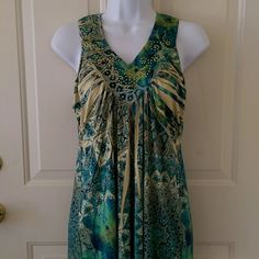 Blue/Green Sleeveless Top Cute top for spring and summer!  Pretty pattern with blue, green, and gold along with gold embellishments along the neckline. Size is petite S. Apt. 9 Tops