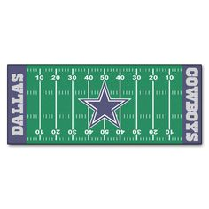 This Dallas Cowboys Football Field Rug Runner comes complete with yard lines and hash marks for an authentic gridiron appearance. An oversized Cowboys logo graces the midfield stripe. This officially licensed product is available for every NFL team.