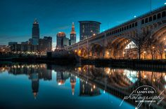 Reflections on the Cuyahoga by At Land's End Photography, via Flickr The skyline of the city of Cleveland, Ohio and the Veterans Memorial Bridge reflected in the Cuyahoga River.