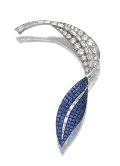 SAPPHIRE AND DIAMOND BROOCH, CIRCA 1960 Designed as a twisted leaf, decorated with calibré-cut sapphires in concealed settings and brilliant-cut and baguette diamonds, mounted in platinum, French assay and maker's marks.