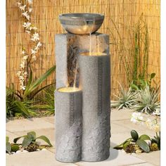 Maybe too 'formal'. but a vertical water feature might be a great choice. There are lots of options. This one is Faux Marble Bowl and Pillar Indoor Outdoor Fountain Decorative Water Fountain, Tabletop Water Fountain, Garden Water Fountains, Indoor Fountain, Wall Fountains, Indoor Outdoor, Outdoor Living, Outdoor Ideas, Modern Fountain