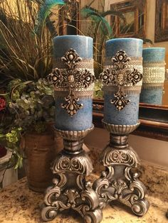 Pair of 4 x 9 decorative embellished mottled blue scented candles with layered ribbon and rhinestone trim, accented with silver cross can… Tuscan Decorating, Decorating Tips, Decorating Candles, Candle Decorations, Candle Stand, Candle Holders, Vasos Vintage, Chandeliers, World Decor