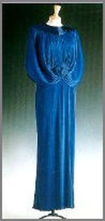 Designed by Yuki for the Princess of Wales, this royal blue Fortuny-style dress decorated with blue bugle beads at the neckline and waist was worn on a state visit to Japan in 1986. The dress raised $ 25,300 for Diana's charities in the Christie's auction in June 1997.