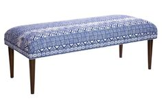 The perfect mix of midcentury and bohemian styles, this blue and white bench is the perfect versatile piece for any living room!