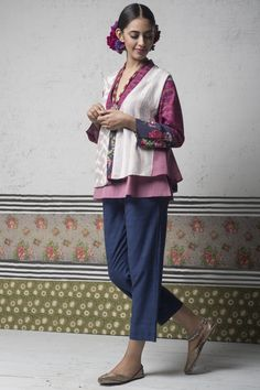 """WANDERING STAR Free-spirited silhouettes in ikat cotton and mangalgiri fabrics, layered with patchwork, appliqué and calligraphic embroidery that traces the word 'Najma' in Urdu, meaning """"wandering star."""""""