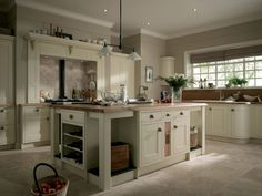 Kitchen Designs. Wonderful Warm Neutral Ivory Classic Country Curved Units and Painted Wood Kitchen Design with Solid Oak Worktop and Door Handles. 25 Classic Elegant Kitchen Design Ideas
