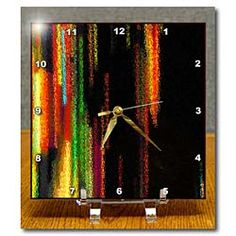 Streaks of color going down a page and made into a glass like picture Desk Clock
