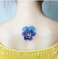 Rita Kit flower tattoo