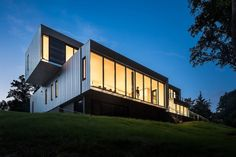 Aluminum-clad Bridge House has floor-to-ceiling windows that blur the line between indoor and outdoor space.