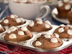 Enjoy your favorite mug of hot chocolate in a muffin form with our easy recipe for Hot Chocolate Muffins! These chocolatey muffins are topped with mini marshmallows, so that they don't just look like the