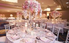 Pink floral centerpieces with white orchids and crystal prisms