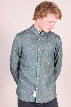 http://www.foxandfeather.co.uk/collections/mens-new-in/products/native-youth-star-print-shirt  Native Youth Star Print Shirt. Lightweight green fabric shirt with all over white star print.