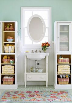 Try adding vertically stacked shelves to give you more room for organization in a small half bathroom. You'll be amazed by how much storage space you'll gain.