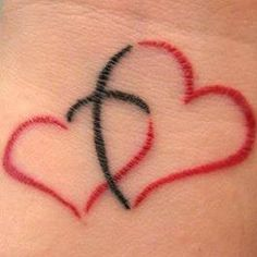 I have this tattoo , but my cross is purple. I got it at 42 years old as a…