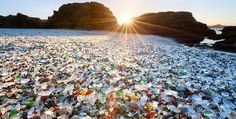 Glass Beach, Hawaii  The pounding ocean waves smoothed and weathered these pieces of glass over time (anywhere from ten to 30 years) on Glass Beach, located on the island of Kauai.