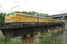 U.P E-9's trains & bridges  U.P passenger train operation lifesaver cross the Fox river in Elgin ILL on the old CNW line